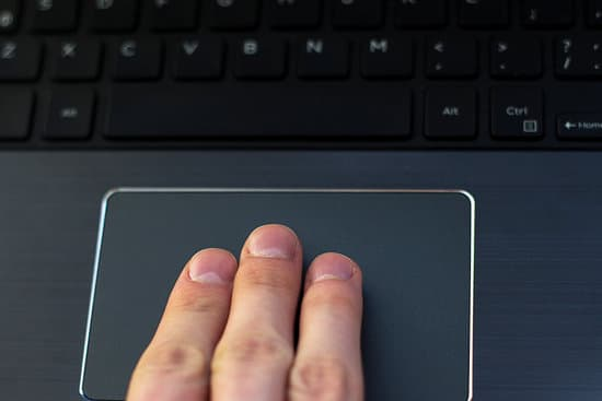 Three Finger Gesture On A Laptop Trackpad